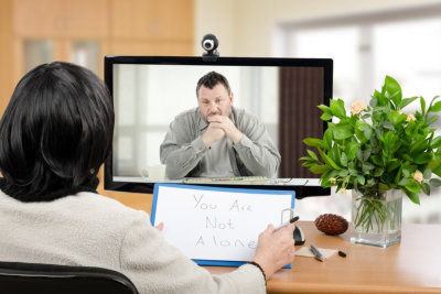 Couple in meeting with a relationship counselor in her office