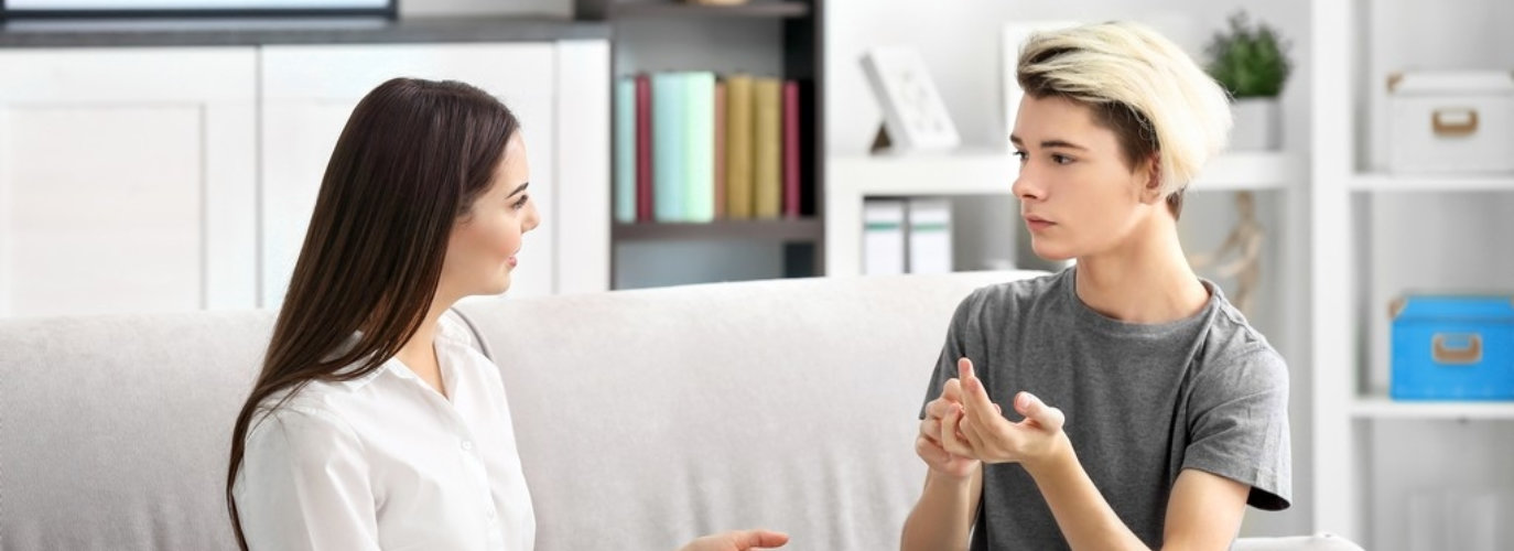 adult woman talking to a young man